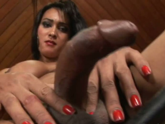 Filthy busty tanned ladyboy squeezes her big dick hard - Shemale porn