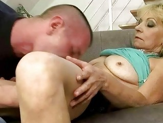 Young man fucks hot granny on the couch