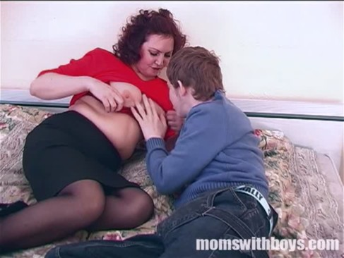 Redhead Kinky Mama Gets Lucky Fucking A Boy In Bed