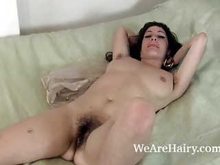 Stacey Stax sucks on a plum and masturbates on bed