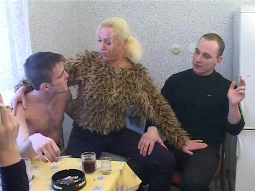 In Her Kitchen She Sucks One Guy While Fucking Another
