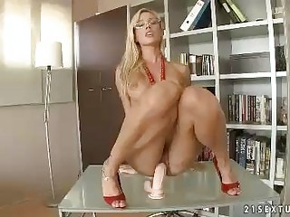 Sexy Vega Vixen riding her wet slit on a large fat dildo toy