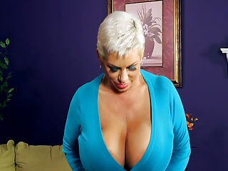 Short-haired milf with huge tits