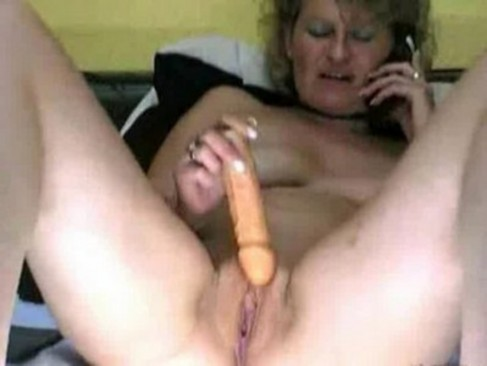 Old woman toying her ass and pussy