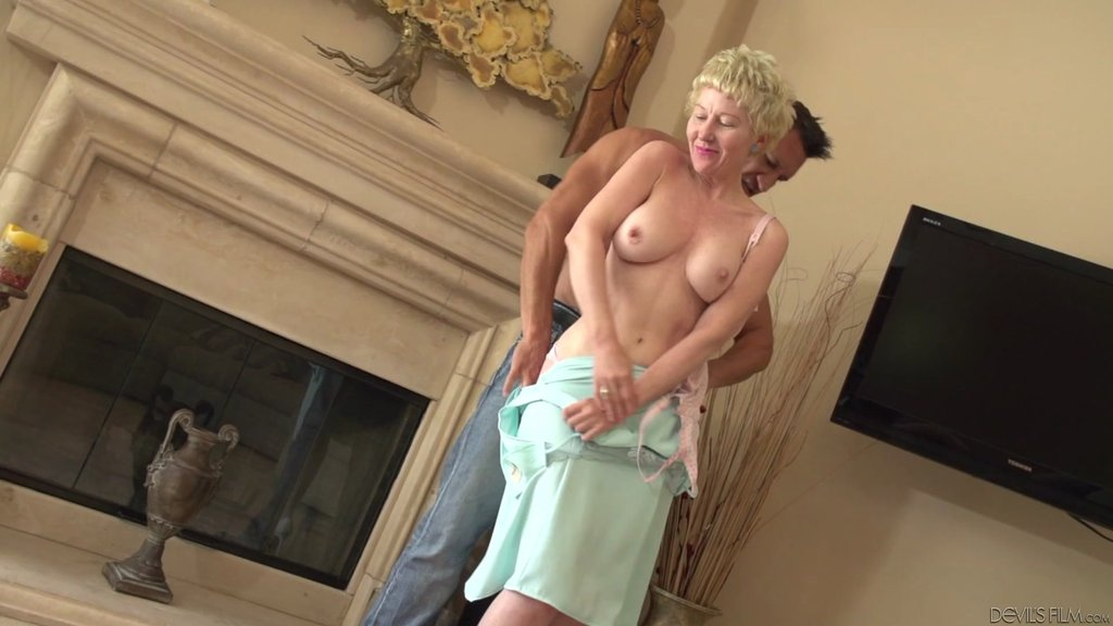 Lingerie-Clad Granny With Short Blonde Hair Enjoying A Hardcore Cowgirl Style Fuck