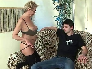 Handsome boy fucks horny granny