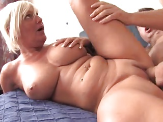 Busty Mature prefers young cock
