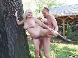 Busty granny gets pounded in the back yard
