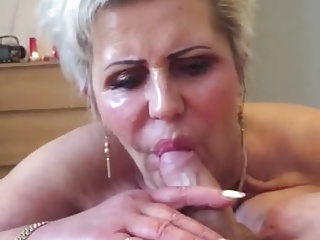 Guy busts his nut right into a granny's mouth