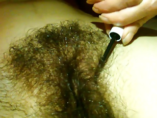 Wife grooming her hairy pussy