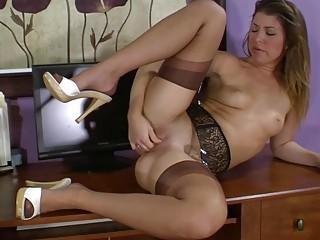 Brunette Babe Teasing In Stockings
