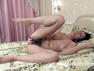 Ramira masturbates in bed after ironing