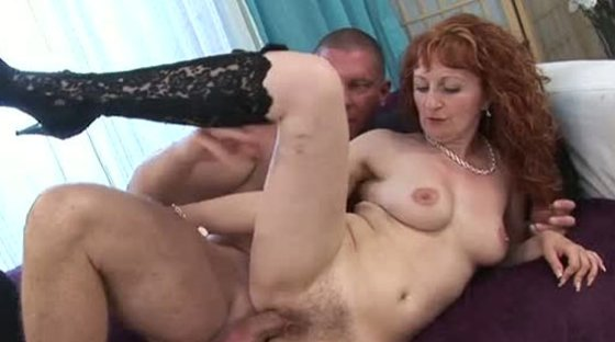 Red haired mature slut in heeled boots gets her hairy twat pleased in sideways style - Hairy porn